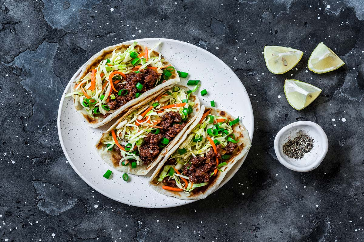 Spicy vegan meat and cabbage, carrots pickled salad tacos