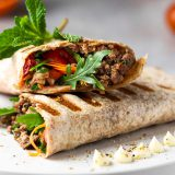 Tortilla-wraps-with-fresh-vegetables-minced-vegan-meat-and-blood-oranges-susta-foods